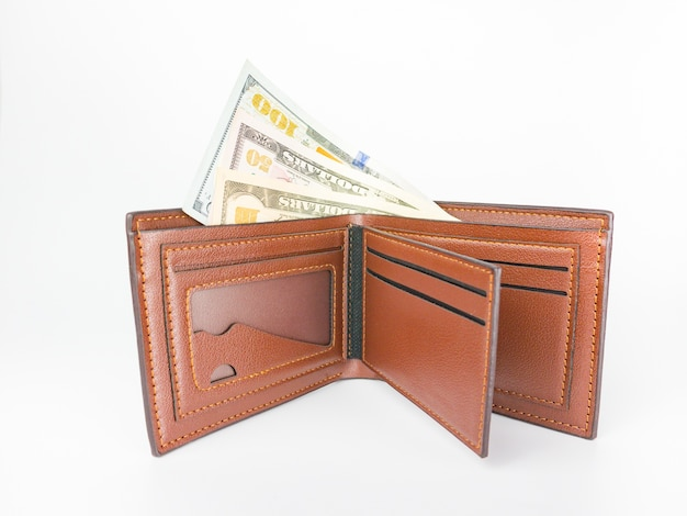 100, 50 , 10 us. dollar banknote in the brown wallet on white background