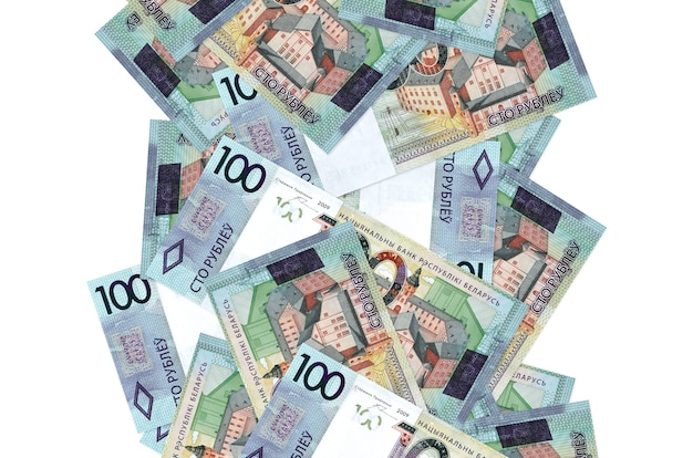 100 belorussian rubles bills flying down isolated on white