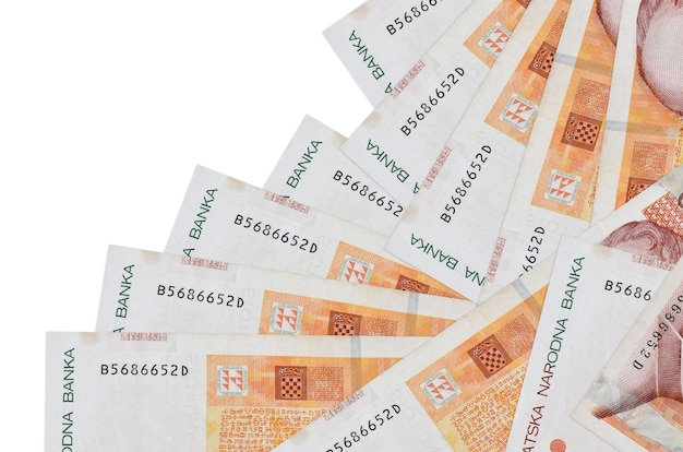 100 croatian kuna bills lies in different order isolated on white