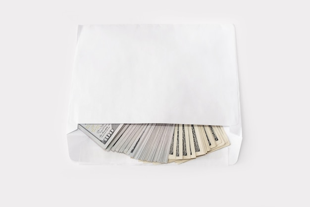 100 dollar banknotes in a white envelope on a white background