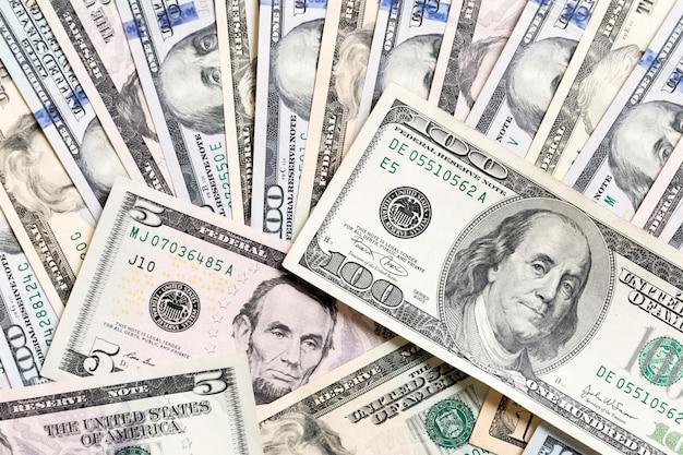 100 dollar bill on dollar banknotes top view