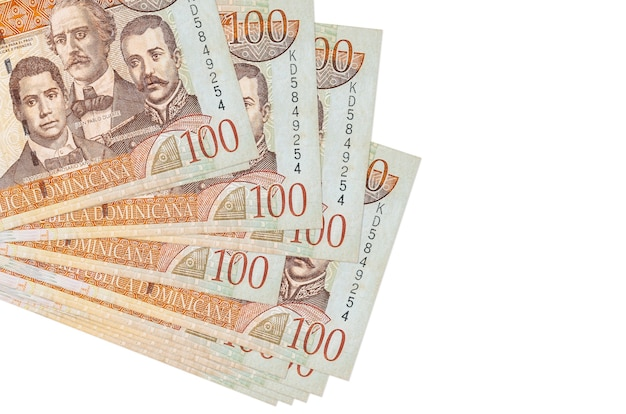 100 dominican peso bills lies in small bunch or pack isolated  .   business and currency exchange concept