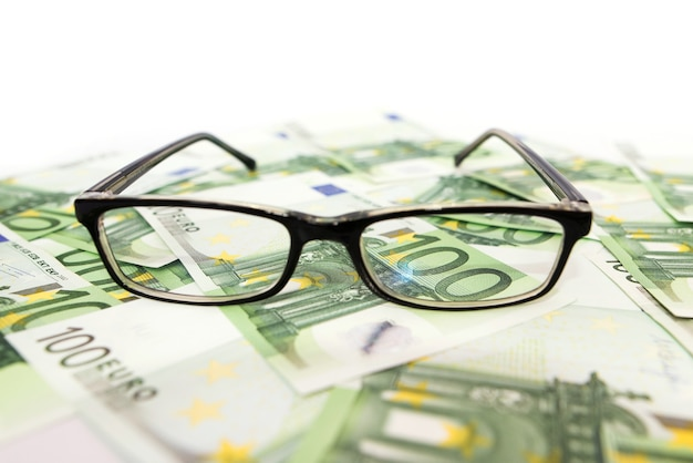 100 euro banknotes and glasses.