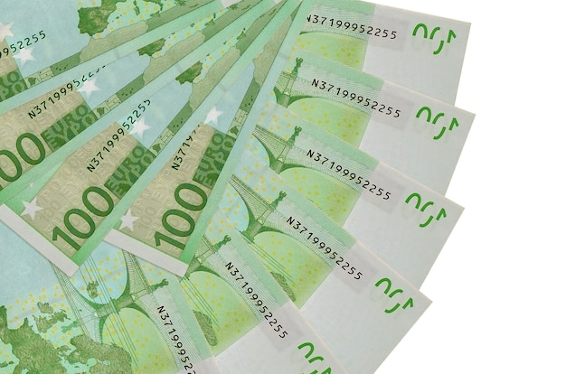 100 euro bills lies isolated on white background with copy space stacked in fan shape close up