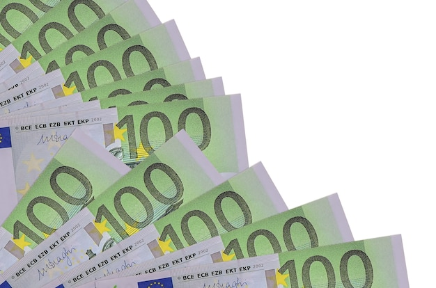 100 euro bills lies isolated on white wall with copy space stacked in fan close up. payday time concept or financial operations