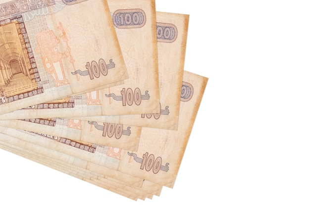 100 guatemalan quetzales bills lies in small bunch or pack isolated on white.  business and currency exchange concept Premium Photo