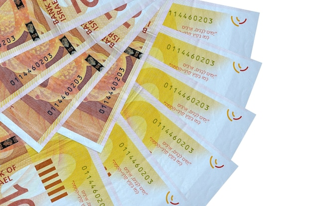 100 israeli new shekels bills lies isolated on white wall with copy space stacked in fan shape close up. financial transactions concept