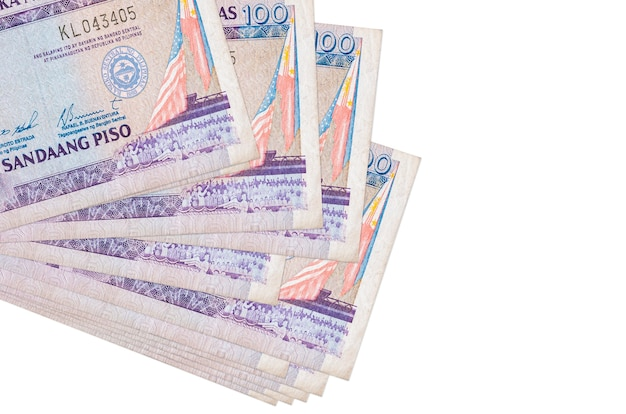100 philippine piso bills lies in small bunch or pack isolated on white.  business and currency exchange concept