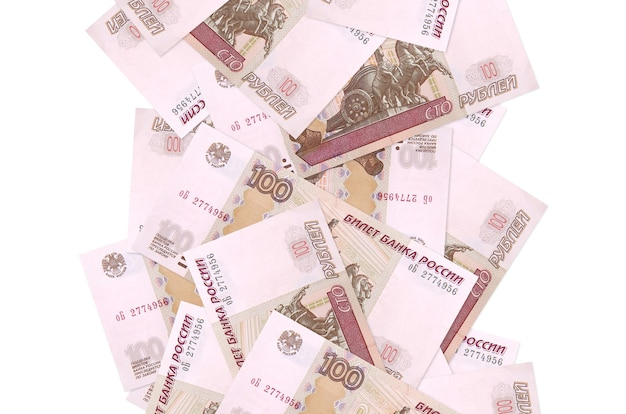 100 russian rubles bills flying down isolated on white. many banknotes falling with white copy space on left and right side