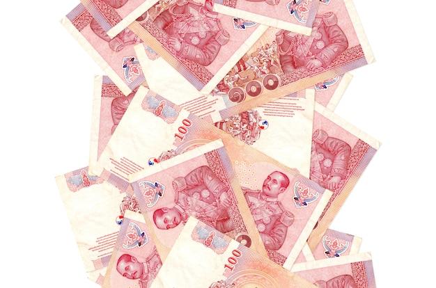 100 태국 바트 지폐에 고립 된 흰색 아래로 비행. 왼쪽과 오른쪽에 흰색 복사 공간이 떨어지는 많은 지폐