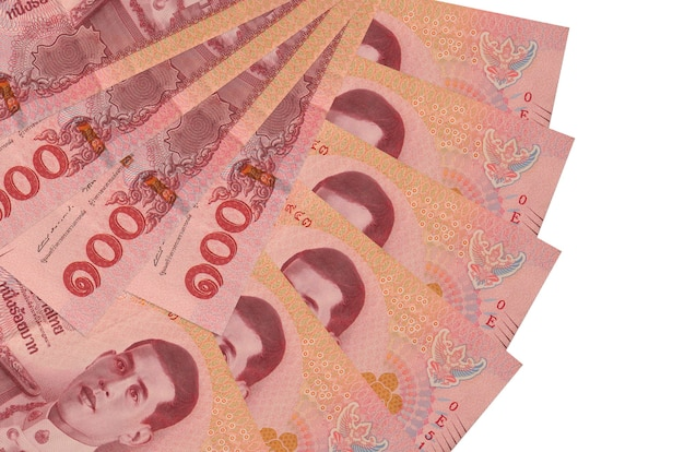 100 thai baht bills lies isolated on white background with copy space stacked in fan shape close up