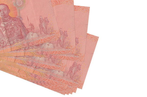 100 thai baht bills lies in small bunch or pack isolated on white