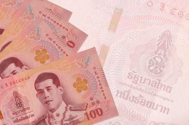 100 thai baht bills lies in stack on wall of big semi-transparent banknote. abstract business wall with copy space