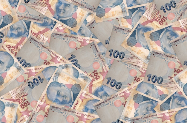100 turkish liras bills lies in big pile. rich life conceptual wall. big amount of money