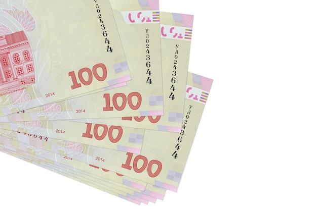 100ウクライナグリブナの請求書は白で隔離された小さな束またはパックにあります。ビジネスと外貨両替の概念