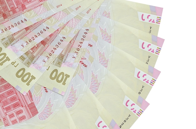 100 ukrainian hryvnias bills lies isolated on white background with copy space stacked in fan shape close up