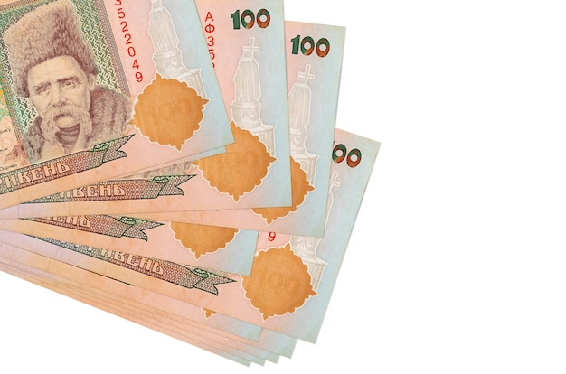 100 ukrainian hryvnias bills lies in small bunch or pack isolated on white.  business and currency exchange concept