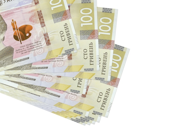 100 ukrainian hryvnias bills lies in small bunch or pack isolated on white
