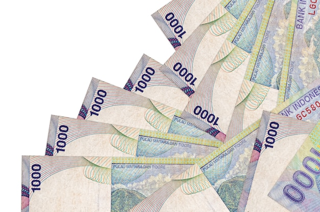 1000 indonesian rupiah bills lies in different order isolated  . local banking or money making concept.