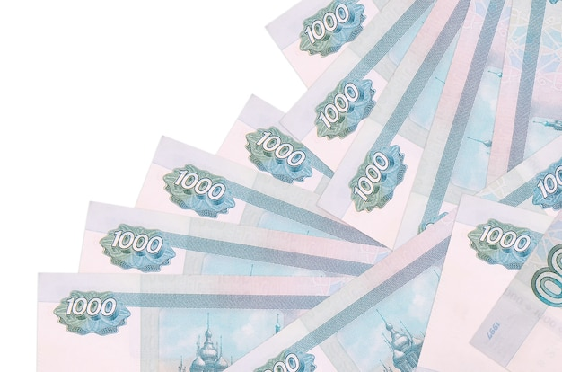 1000 russian rubles bills lies in different order isolated on white. local banking or money making concept.