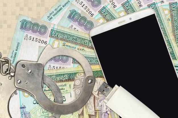 1000スリランカルピー紙幣と警察の手錠付きスマートフォン