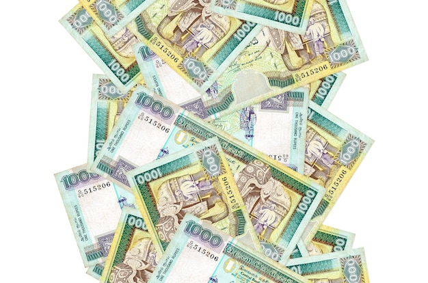 1000 sri lankan rupees bills flying down isolated on white. many banknotes falling with white copy space on left and right side