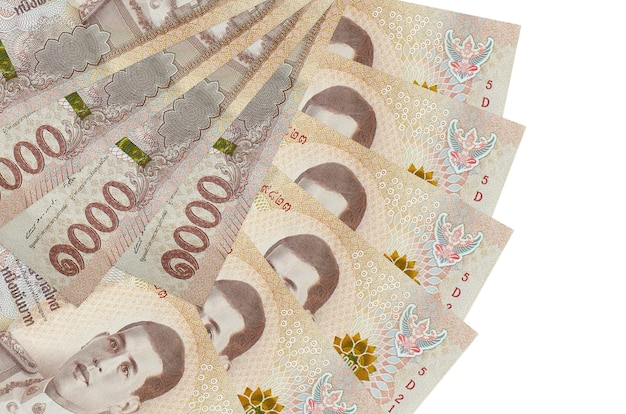 1000 thai baht bills lies isolated on white wall with copy space stacked in fan shape close up. financial transactions concept