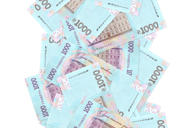 1000 ukrainian hryvnias bills flying down isolated on white. many banknotes falling with white copy space on left and right side