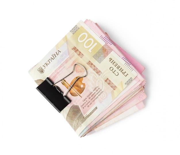 Сложенная стопка бумажных купюр украины, номиналом 100 гривен