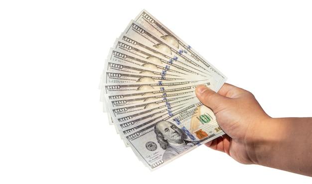 手の影が落ちる100ドル紙幣