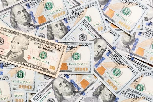 米ドル紙幣。 100ドル札の背景。背景にビジネスコンセプトのトップビュー