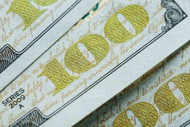 Макро крупным планом лица бена франклина на 100 долларов сша