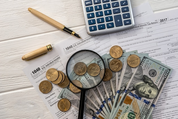 1040 form with dollars, magnifier and calculator