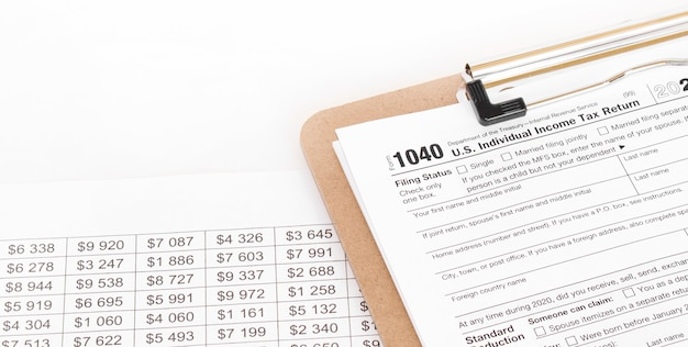 1040 tax form being filled out. shallow depth of field