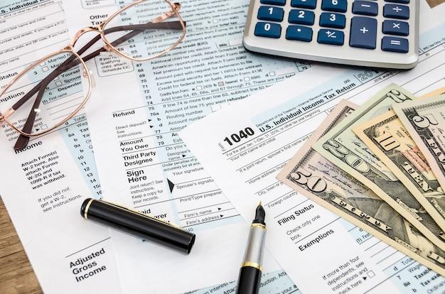 1040 tax form, dollar and calculator