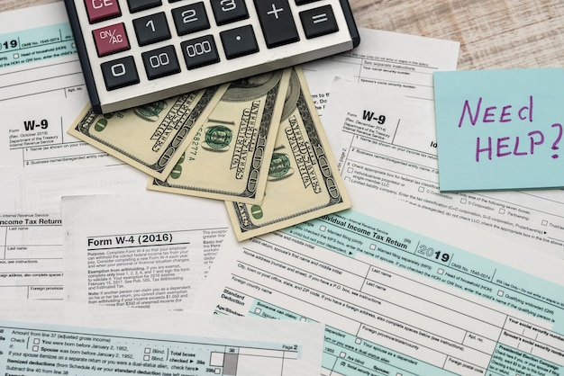 1040 tax form in office with need help text
