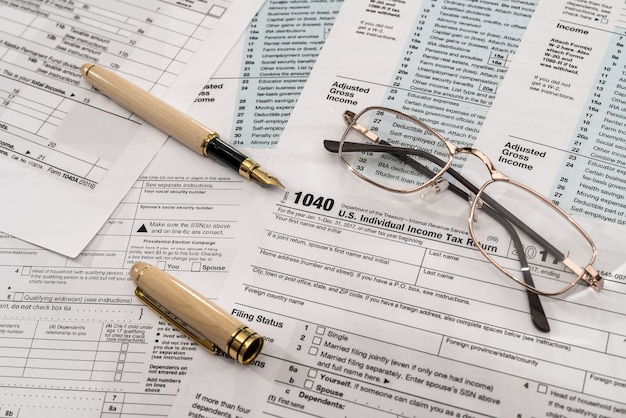 1040 tax form with pen and spectacles