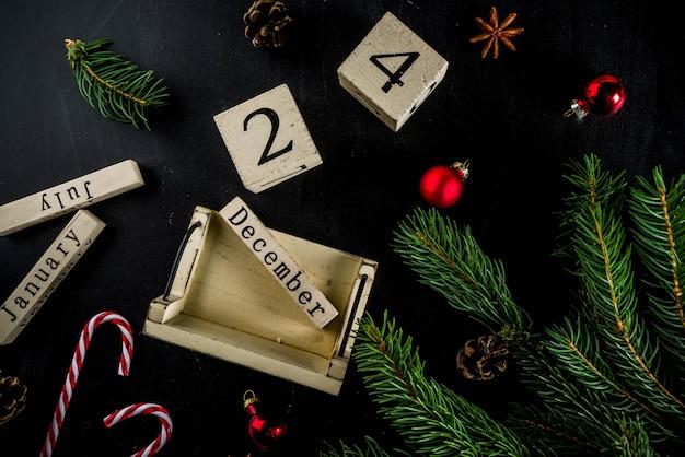 クリスマスコンセプトデコレーション、モミの木の枝、カレンダー12月24日