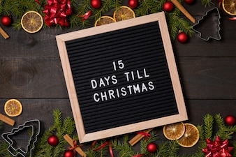 15 Days till Christmas countdown letter board on wood background