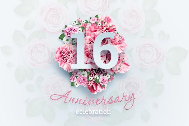 創造的なレタリング16の数字とピンクの花の記念日のお祝いのテキスト。お祝いイベント、テンプレート、チラシ