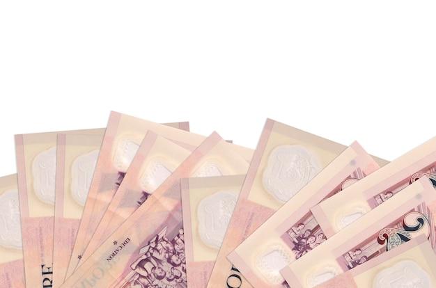 2 싱가포르 달러 지폐 복사 공간 흰 벽에 고립 된 화면의 아래쪽에 놓여 있습니다.