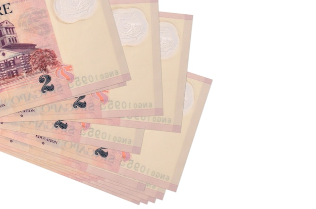 2 singaporean dollars bills lies in small bunch or pack isolated.