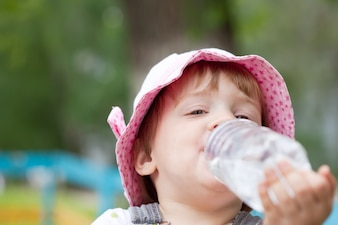 2 years child drinking from  bottle
