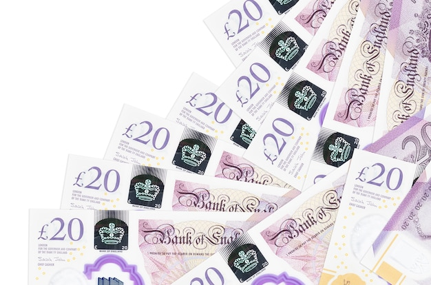 20 british pounds bills lies in different order isolated on white. local banking or money making concept.