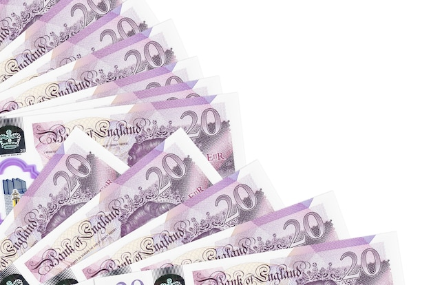 20 british pounds bills lies isolated on white wall with copy space stacked in fan close up. payday time concept or financial operations