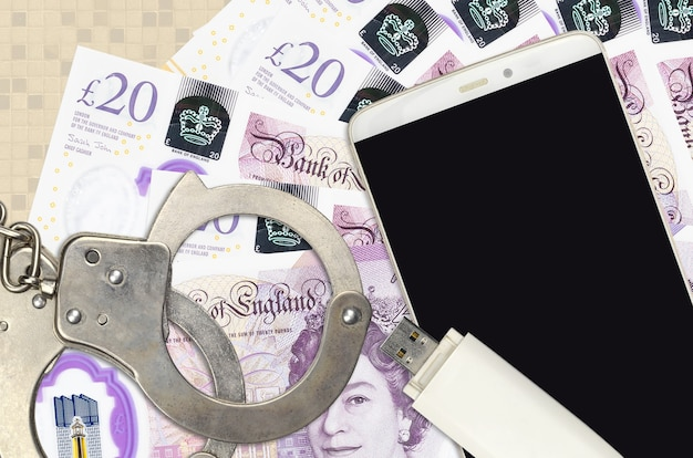 20 british pounds bills and smartphone with police handcuffs.