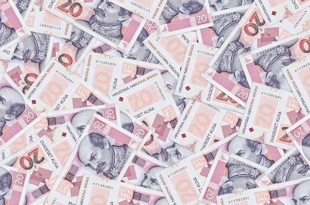 20 croatian kuna bills lies in big pile