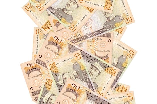 20ドミニカペソ紙幣が白で隔離されて飛んで