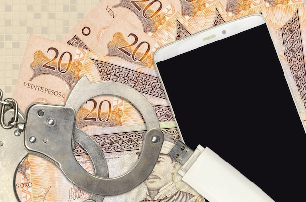 20 dominican peso bills and smartphone with police handcuffs. concept of hackers phishing attacks, illegal scam or online spyware soft distribution
