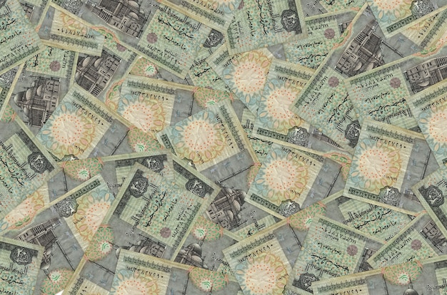 20 egyptian pounds bills lies in big pile. . big amount of money